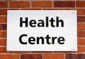 Health centre sign shows the way to the entrance Stock Photos