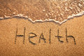 Health concept text on the beach Royalty Free Stock Photos
