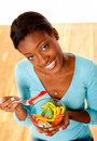Health conscious woman eating salad