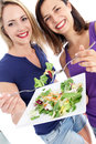 Health conscious women enjoying salad Royalty Free Stock Photo