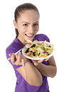 Health conscious young woman beautiful attractive happy smiling vegetarian eating healthy fresh organic salad from a plate Stock Image