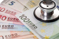 Health costs money many euro banknotes and stethoscope Royalty Free Stock Photo