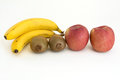 Health diet bananas apples and kiwi Royalty Free Stock Image