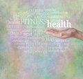 Health and fitness word wall male hand outstretched with the floating above surrounded by relevant words on a stone effect green Stock Photos