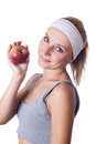 Health healthy young woman presenting an apple holding beautiful smiling Royalty Free Stock Photos