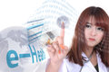 Health information by e health system female doctor point her finger to a little global to transfer Stock Image