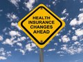 Health insurance changes ahead sign with blue sky and cloudscape background Royalty Free Stock Images