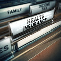 Health insurance concept folder with documents inside of insured person focus on the text and blur effect Stock Photography