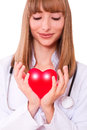 Health insurance or love concept the doctor holding heart Stock Photography
