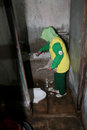 Health official inspect officials the toilet to prevent the development of mosquito larvae that will cause disease in the city of Royalty Free Stock Photos