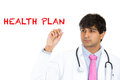 Health plan closeup portrait of serious handsome male care professional or doctor or nurse writing the words isolated on Stock Photo