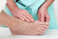 Health problems hallux nurse checking with foot closeup Stock Image