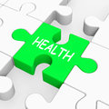 Health puzzle shows medical care and wellbeing showing Royalty Free Stock Photo