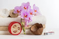 Health spa and flower orchid spa treatment relax with candles relaxation wellness objects including towel massage Royalty Free Stock Photo