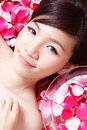 Health spa woman Face close up with red rose Royalty Free Stock Images