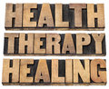 Health therapy and healing words collage of isolated text in vintage letterpress wood type printing blocks Stock Photo