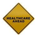 Healthcare ahead yellow sign with isolated on white background Royalty Free Stock Image
