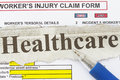 Healthcare newspaper cutout with blank worker s claim form Royalty Free Stock Image
