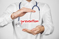 Healthcare prevention doctor general practitioner concept doctor with protective gesture and text Stock Photo