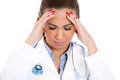 Healthcare professional with headache stressed nurse doctor with migraine overworked and overstressed closeup portrait of isolated Royalty Free Stock Image