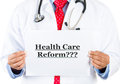 Healthcare professional holding up health care ref closeup portrait of with red tie and stethoscope a sign which says reform Stock Photography