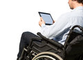 Healthcare wheelchair user disabled young men looking at digital tablet Royalty Free Stock Photography