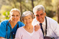 Healthcare workers senior close up portrait of and patient outdoors Royalty Free Stock Images
