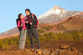 Healthy active lifestyle hiker people hiking in beautiful mountain nature landscape woman and men hikers laughing resting taking Royalty Free Stock Images