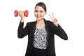 Healthy asian business woman show victory sign with dumbbells isolated on white background Stock Photos