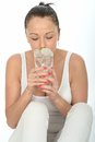 Healthy attractive young woman drinking a glass of iced water dslr royalty free image fresh mineral or tap with ice cubes and Stock Photo