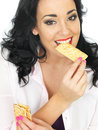 Healthy Attractive Young Woman Eating Mixed Dried Fruit Bars Royalty Free Stock Photo