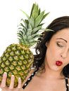 Healthy Attractive Young Woman Holding A Fresh Ripe Pinapple Royalty Free Stock Photo