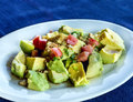 Healthy avocado salad with lettuce tomatoes and nuts Stock Photography