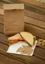 Healthy back to school lunch with veggie sandwich and brown paper bag Royalty Free Stock Images