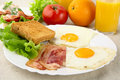 Healthy breakfast with bacon, eggs,toast and glass of juice Royalty Free Stock Photo