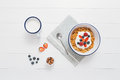 Healthy breakfast with cereals and berries in an enamel bowl Royalty Free Stock Photo