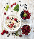 Healthy breakfast cereals with fresh fruits on a wooden background Royalty Free Stock Photos