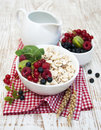 Healthy breakfast cereals with fresh fruits on a wooden background Stock Image