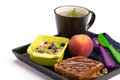 Healthy breakfast with chocolate bread muesli peach and cup of tea Stock Images