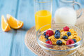 Healthy breakfast concept - cereals with berries, orange juice, orange slices and milk Royalty Free Stock Photo