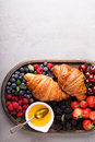 Healthy breakfast with freshly baked croissants and berries Royalty Free Stock Photo