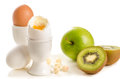Healthy breakfast ingredients boiled eggs fruits nuts white Royalty Free Stock Photo