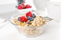 Healthy breakfast with muesli and fresh berries a of on white background Stock Photos