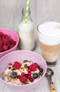 Healthy breakfast with muesli milk berries and coffee on textured background Stock Image