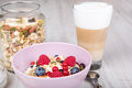 Healthy breakfast with muesli milk berries and coffee on textured background Royalty Free Stock Image
