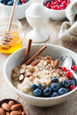 Healthy breakfast Oatmeal porridge with berries, nuts and honey Royalty Free Stock Photo