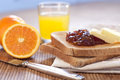 Healthy breakfast with orange jam toast and juice Stock Photos