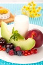 Healthy breakfast with a plate of fresh fruits glass of milk Royalty Free Stock Photography
