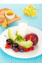 Healthy breakfast with a plate of fresh fruits glass of milk Royalty Free Stock Photos