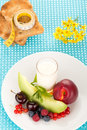 Healthy breakfast with a plate of fresh fruits glass of milk Stock Images